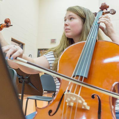 image of girl playing instrument