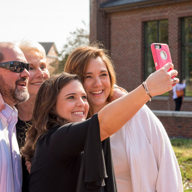 image of family with Campbell University student