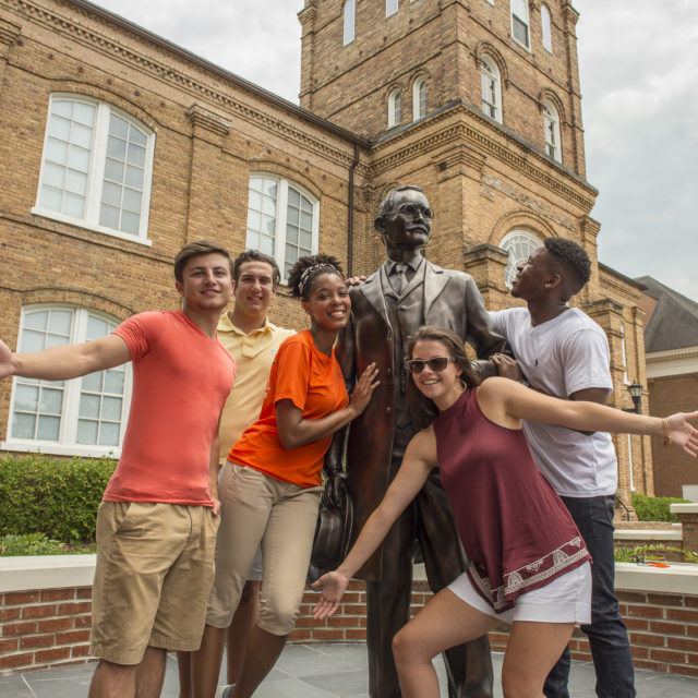 image of students with ja campbell statue
