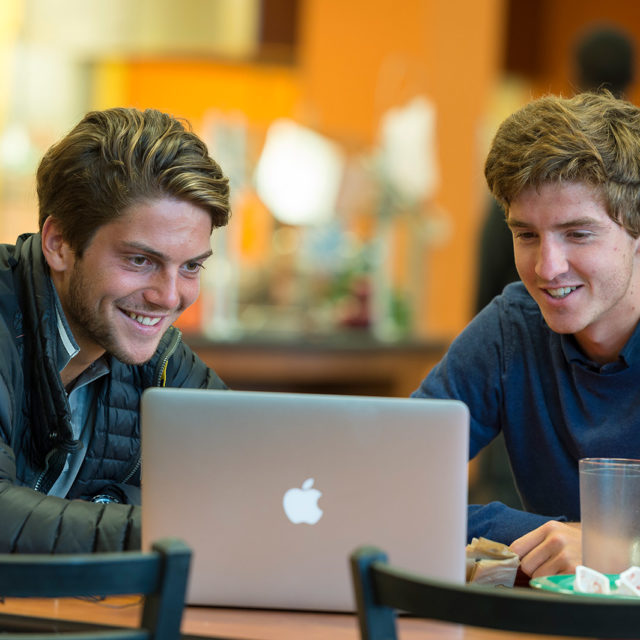 image of two students at computer