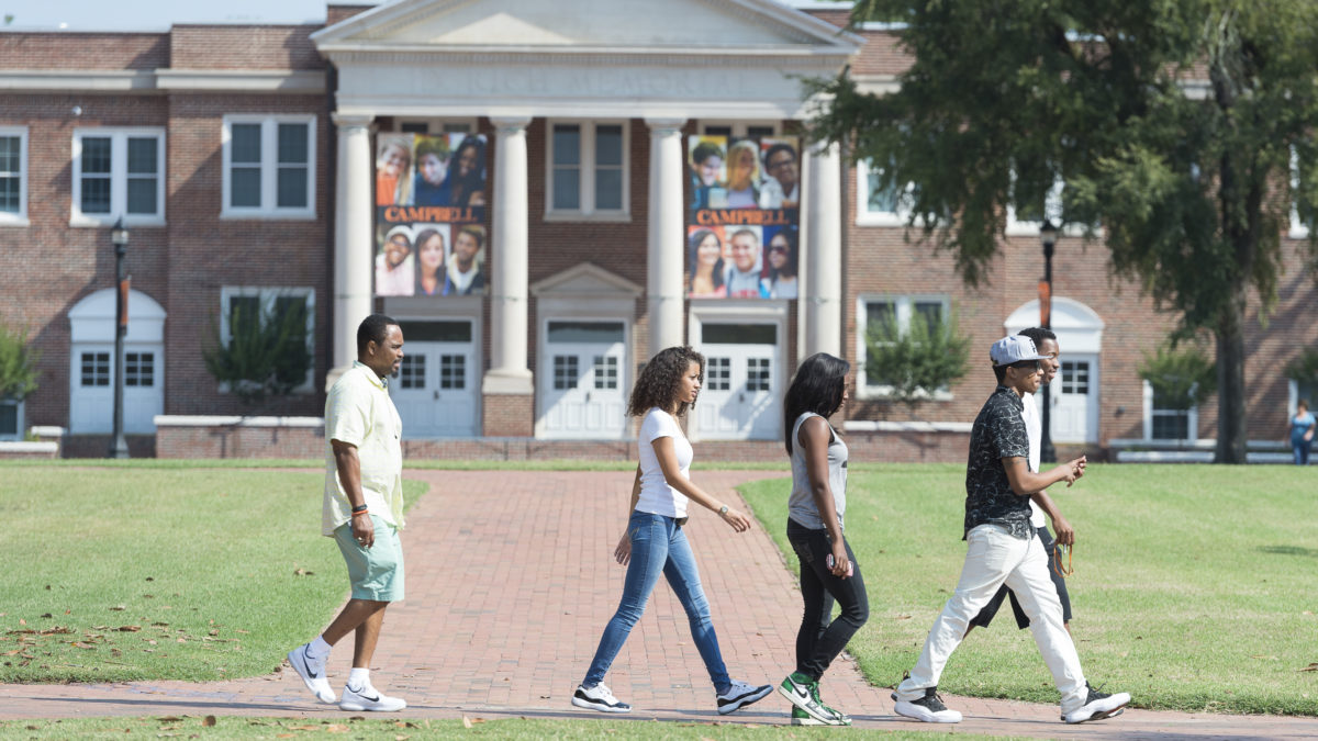 image of students walking in front of d rich
