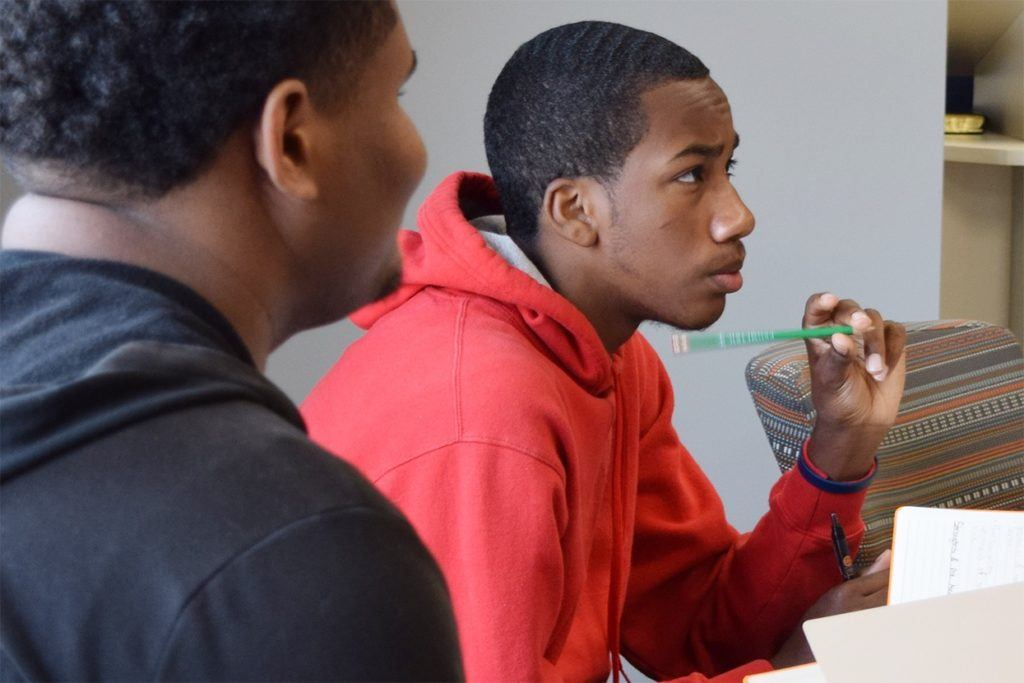 Two male students participate in a classroom session