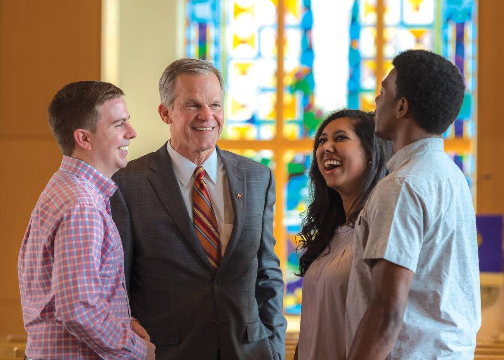 image of Campbell President Dr. Creed with students