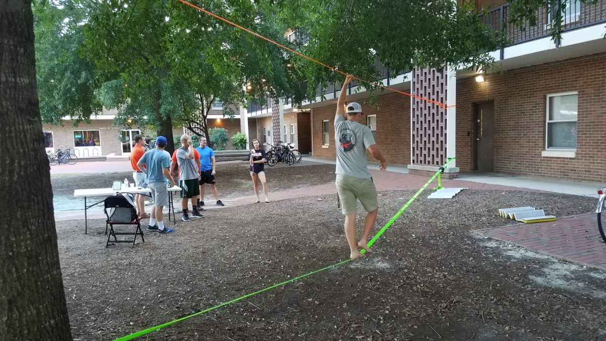 image of student participating in outdoor rec slackline clinic