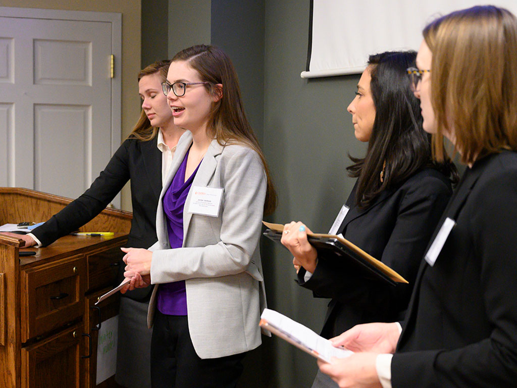 Image of a group of female students giving presentation