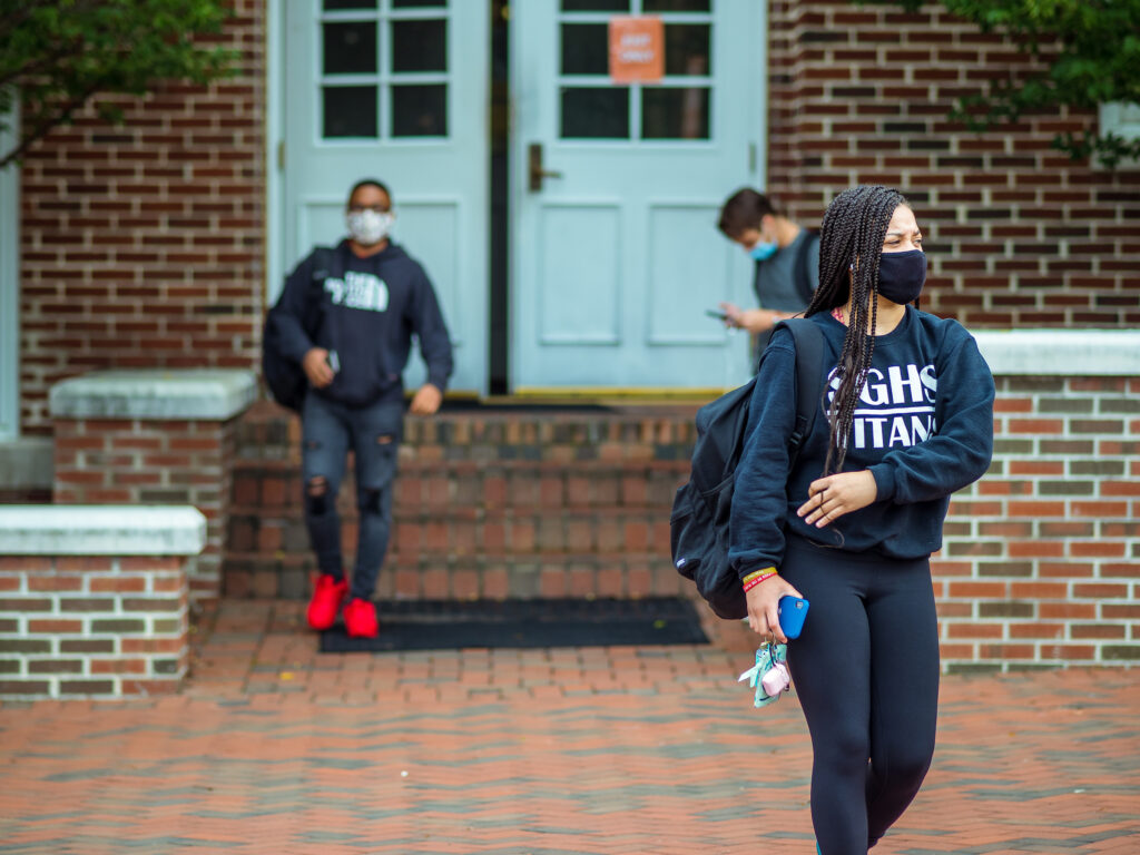 image of students walking with masks