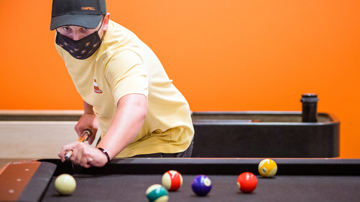 image of person playing pool