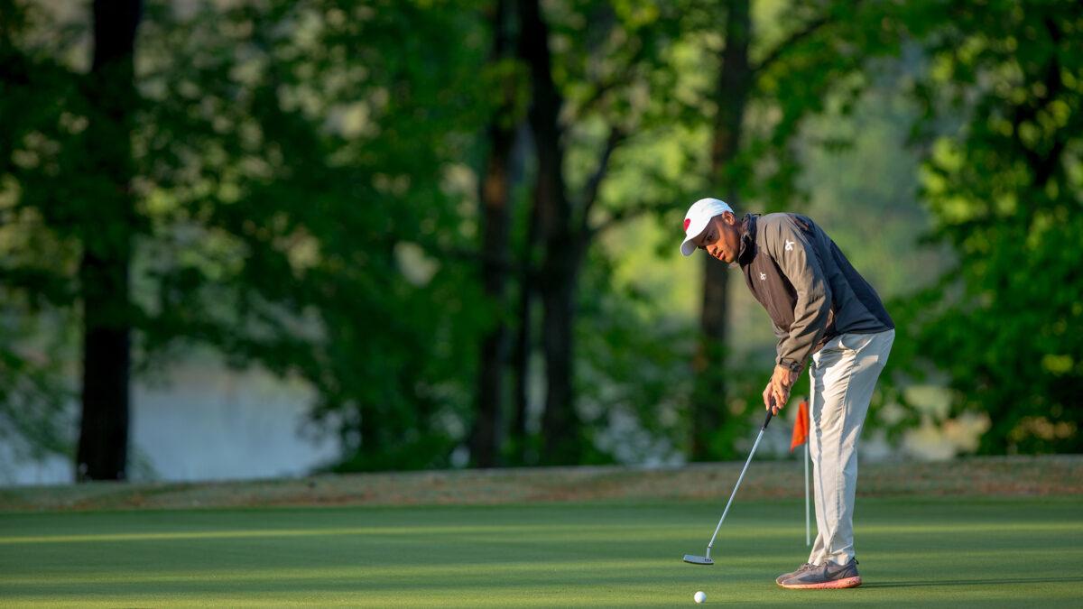 A Campbell golfer makes a putt