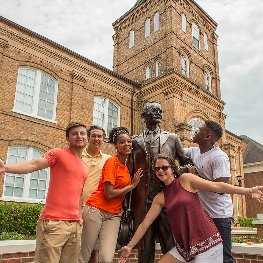 image of students with the JA Campbell statue
