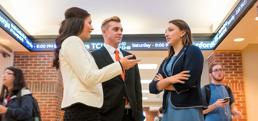image of students talking at the Business School