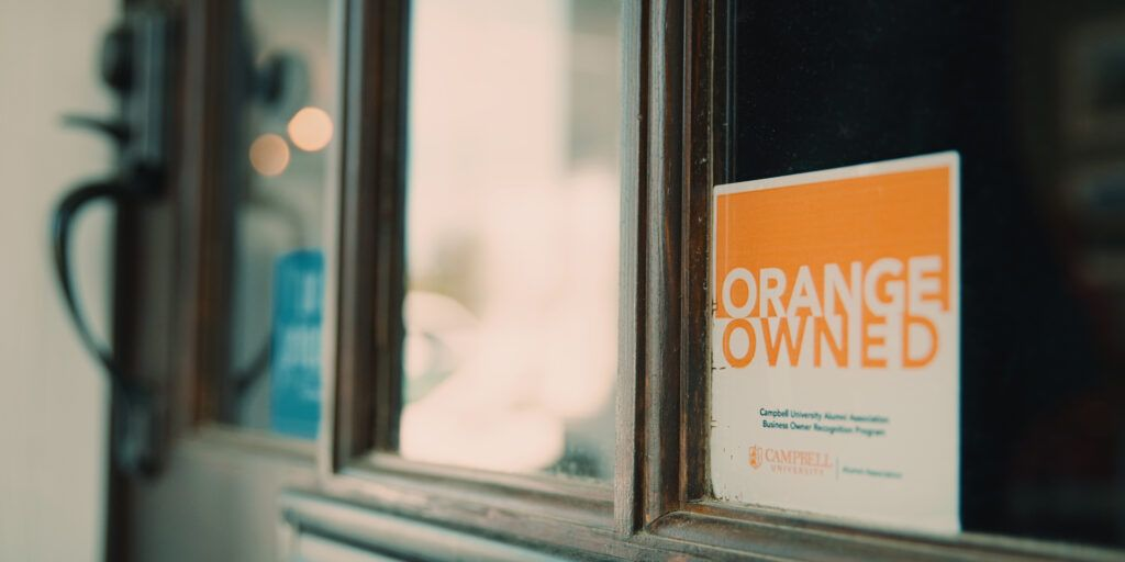 Orange Owned decal in window