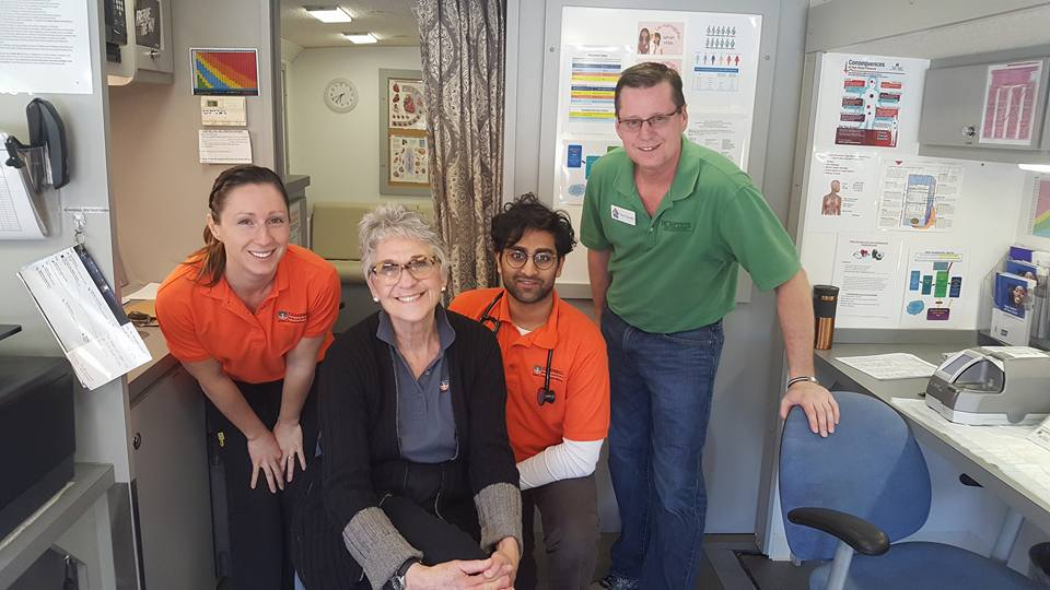 Photo:  Dr. Charlotte Paolini, associate professor of family medicine, with Aakash Patel, Sheena Coffey and a NC Baptist volunteer at the Kennebec Baptist Church mobile clinic day