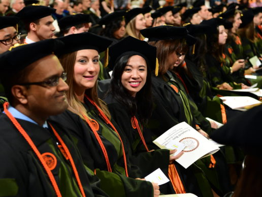 Graduates wait to receive their pharmacy hoods. Photo by Bennett Scarborough