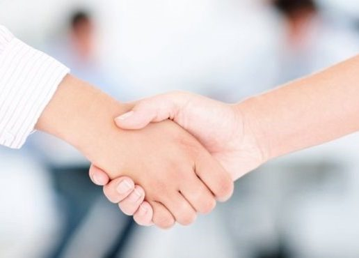 image of professionals shaking hands
