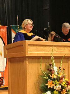 Nursing professor at podium