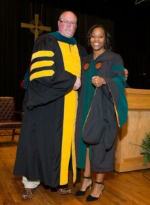 Student receives hood at DPT convocation