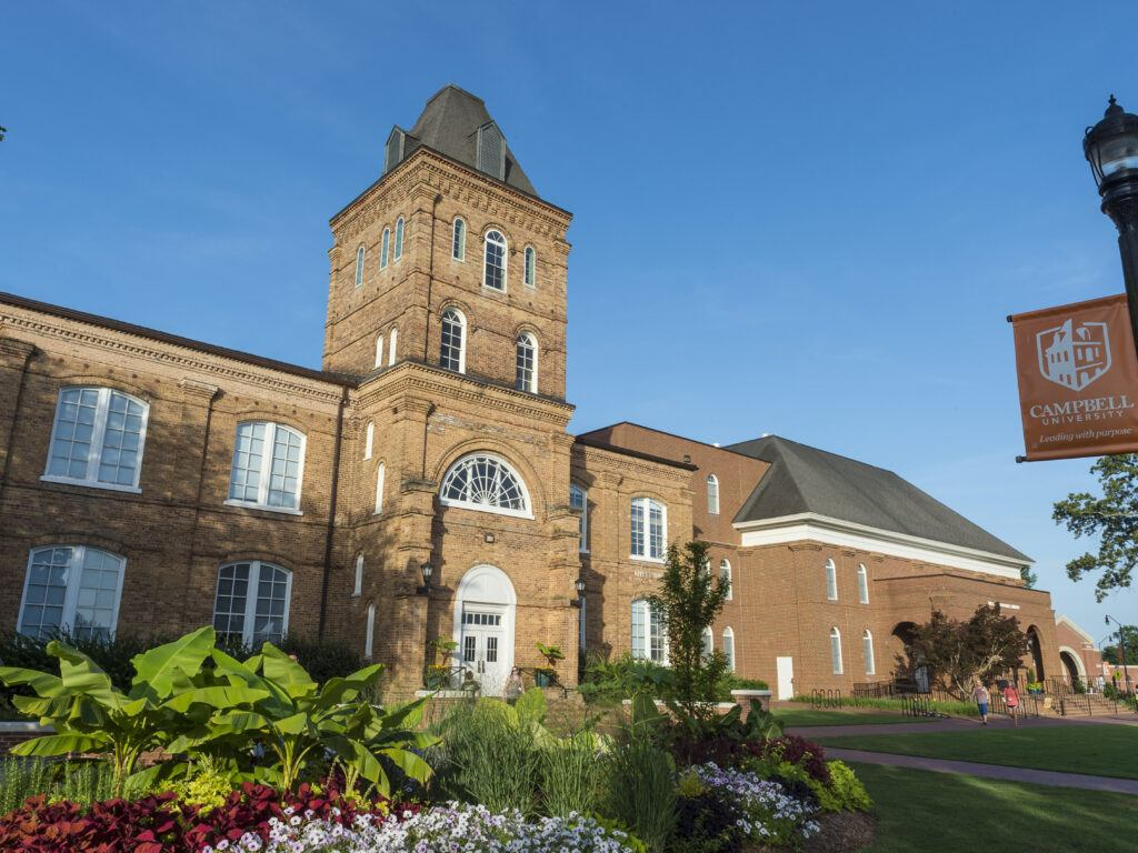The front of Kivett Hall, backed by a blue sky and with landscaping in the foreground.