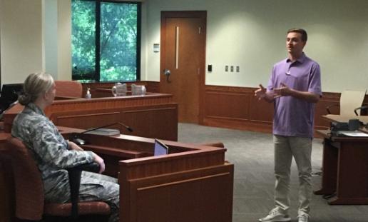 Photo of Keith Boyette (3L) practices his cross-examination.
