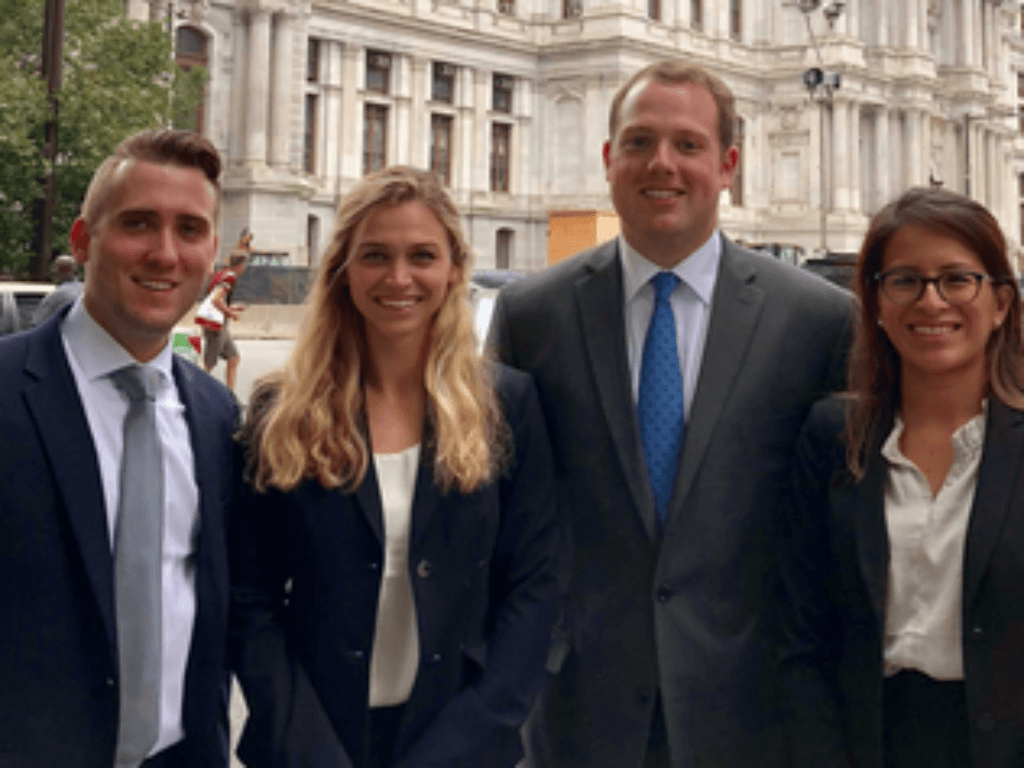 Photo of Adam Webb, Alex Puszczynski, Holden McLemore and Rosa Reyes, who represented Campbell Law at the Battle of the Experts at Drexel University School of Law on Oct. 6–8 in Philadelphia, Pennsylvania.