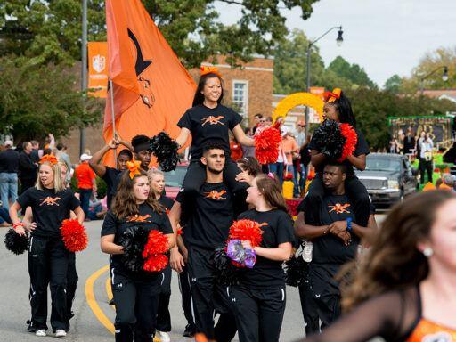cheerleaders at Homecoming parade in black and orange