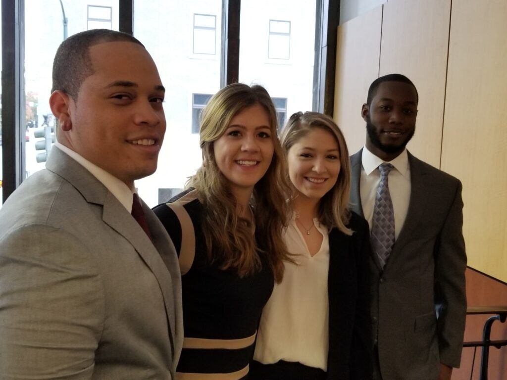 Photo of Second-year law students Kevin Littlejohn, Brooke Webber, Chamberlain Collier and Justin Hill compete in the 2018 ABA Regional Negotiation Competition at Elon Law School in Greensboro on Nov. 10-11, 2018.