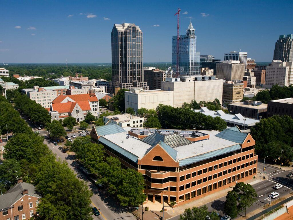 aerial shot of Campbell Law building with Raleigh skyline in background