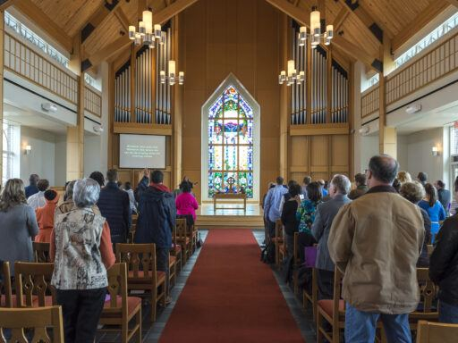 crowd facing stained glass window in Butler Chapel