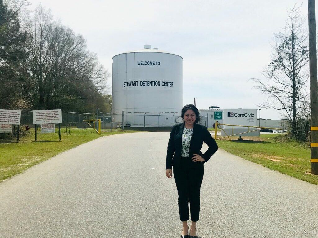 Photo of Jacqui Figueroa standing in front of the detention center