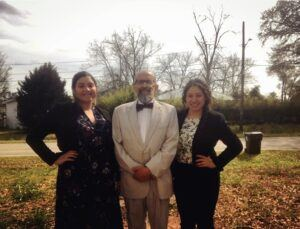Campbell Law 3L Jacqui Figeroa poses with immigration attorney Marty Rosenbluth and his assistant outside the Stewart Detention Center in Lumpkin, Georgia