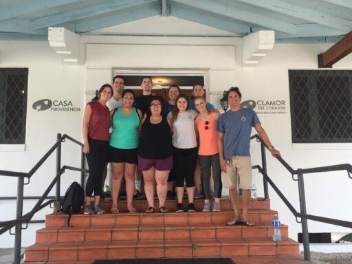Group of Campbell Law student volunteers pose on steps of an orphanage in Panama