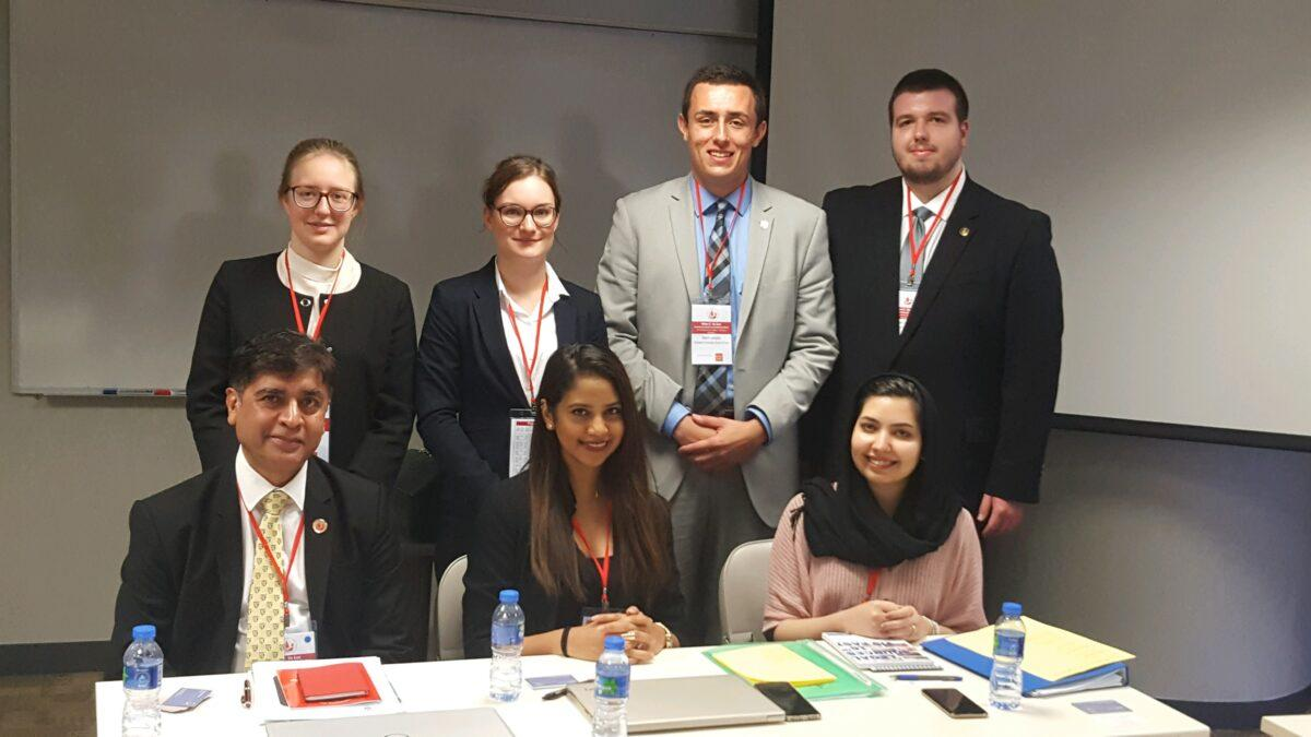 Photo of Vis Trial Advocates with judges posing at a table