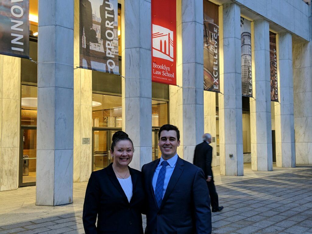 Third-year law students Joonu – Noel Coste and Taylor McCallman pose in front of Brooklyn Law School