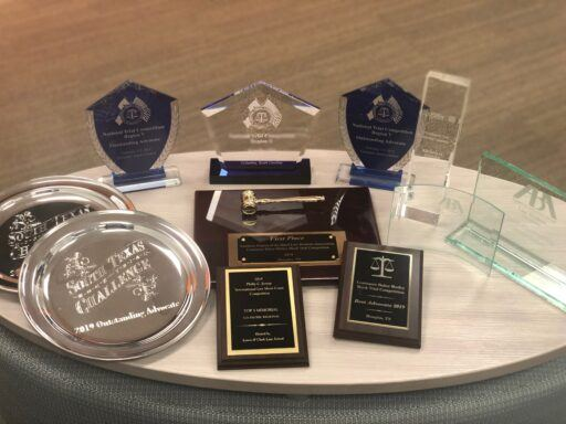 Photo of law school trial advocacy championship trophies and plaques