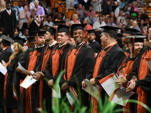 adult and online graduates in line in Gore Arena