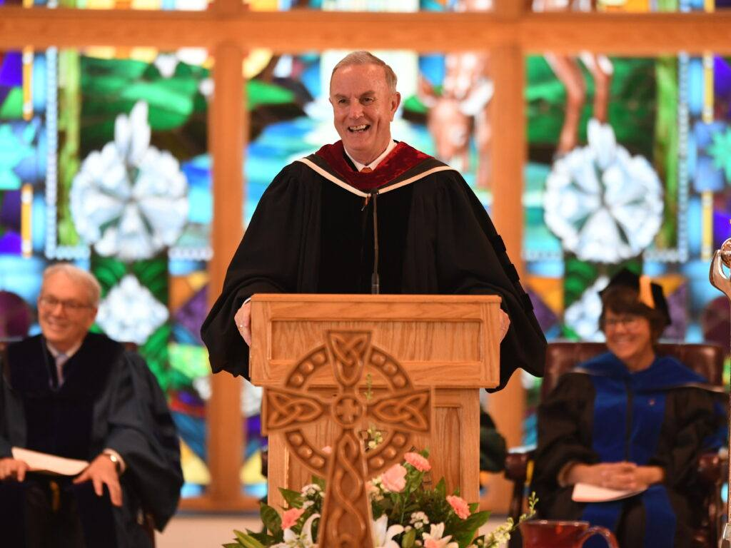 Dr Cogdill at his last commencement (retiring after 36 years) at the podium in Butler Chapel