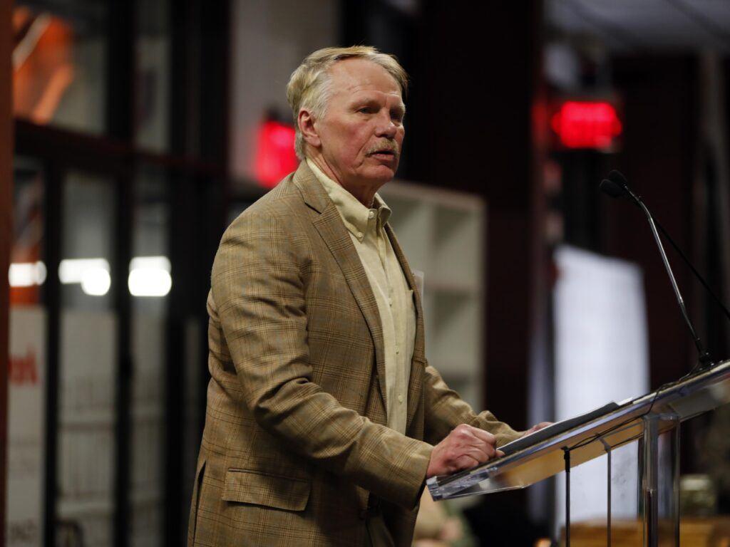 Photo of Dean J. Rich Leonard standing at a podium