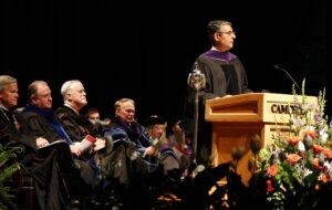 Photo of Judge Diaz at podium giving commencement address
