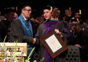 Photo of David Dittmar receiving his LLM award from Nottingham Law School's Matthew Homewood