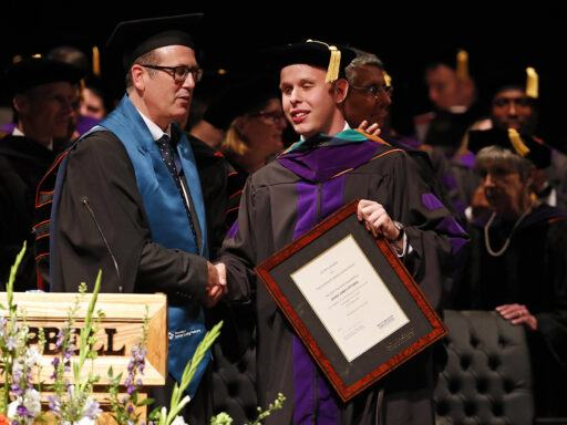 Photo of Derek Dittmar receiving his LLM award from Nottingham Law School's Matthew Homewood