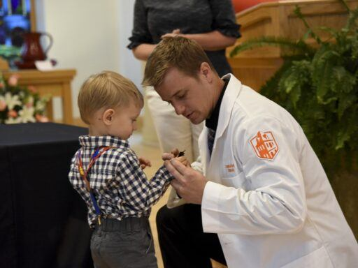 Child pinning nursing student