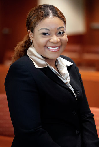 Photo of Tatiana Terry posing in the Boyce Courtroom.