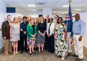 Photo of OJJDP group including Professor Jon Powell  meeting in an office in DC
