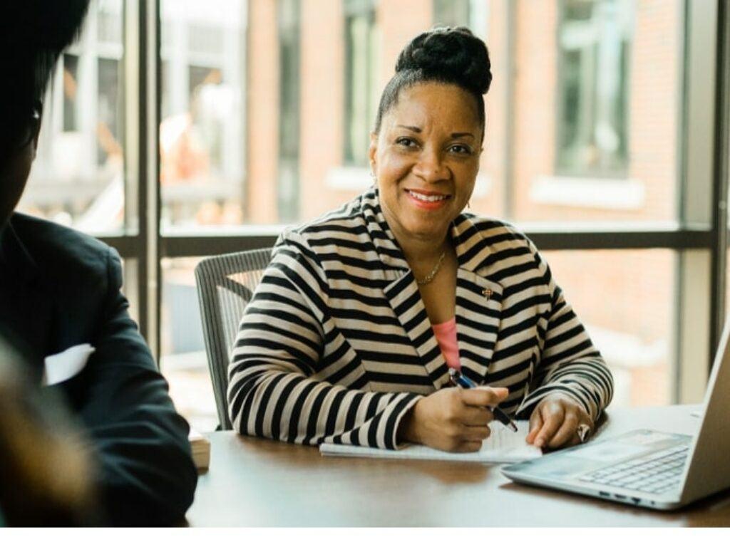 woman studies at desk