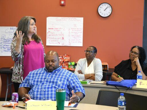 Cheryl Ayers teaching a class of educators
