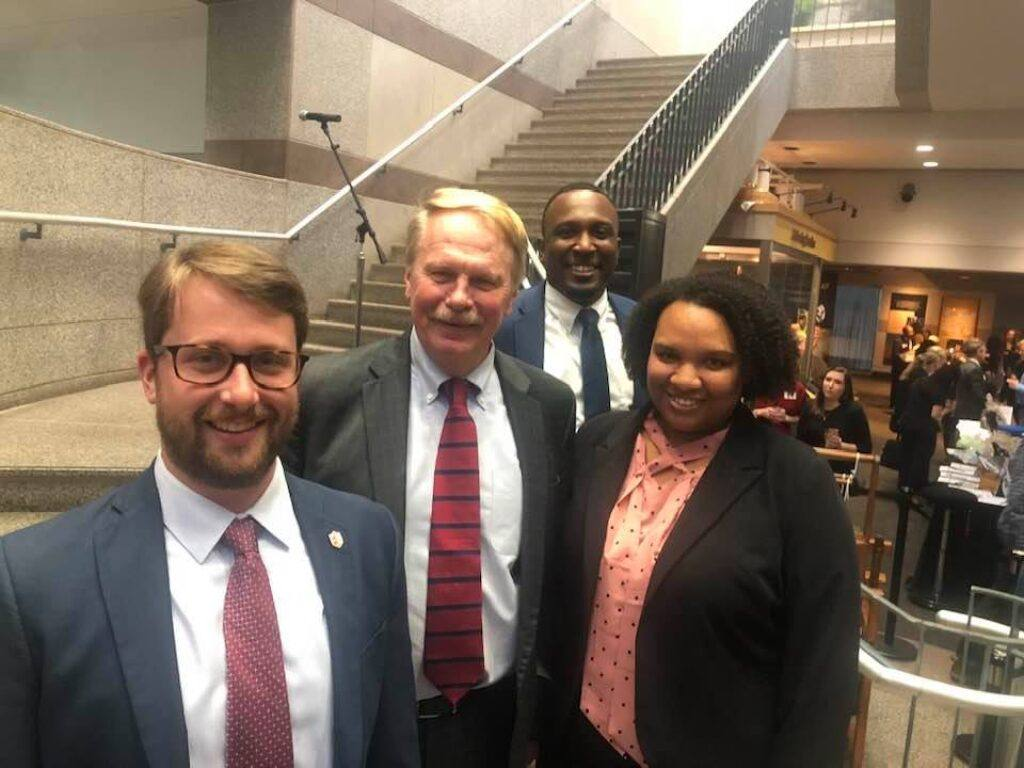 Photo of Grant Simpkins, Dean J. Rich Leonard, Maurizo S. Lewis-Streit and Jonnell Carpenter, all 2019 graduates