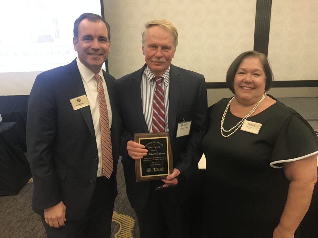 Photo of Dean Leonard receiving the 2019 President's Award from the Wake County Bar Association