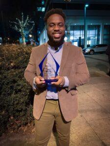 Photo of Daniel Nelson '21 holding best advocate award