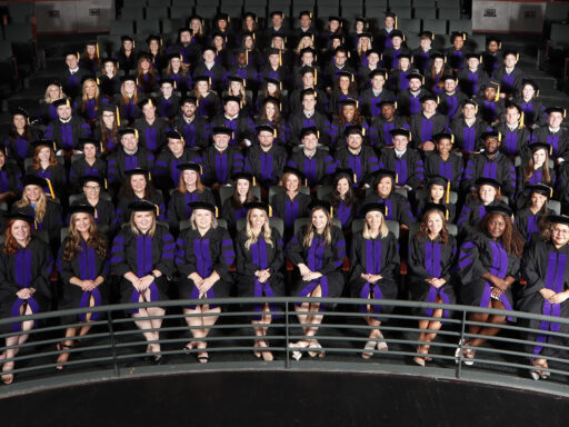 Group photo of Campbell Law alumni dressed in caps and gowns at graduation in 2019
