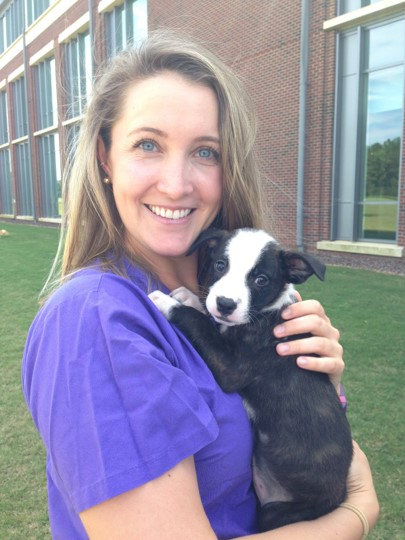 Student Doctor Kara Smith holding a puppy