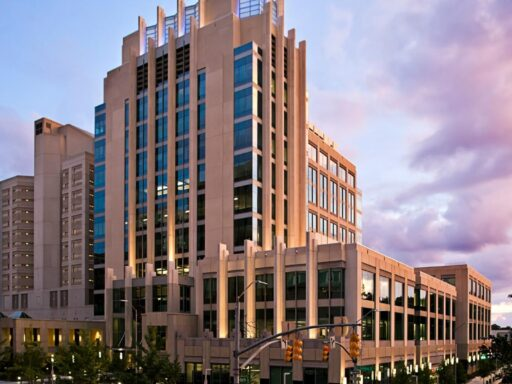Photo of exterior of Wake County Justice Center building at sunset